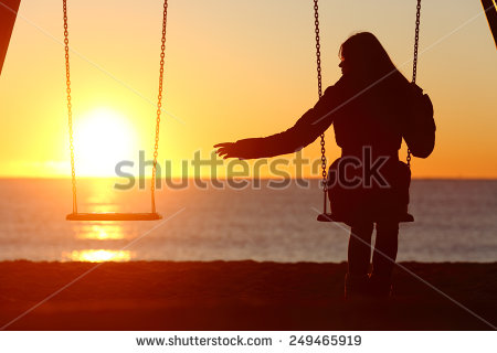 stock-photo-single-or-divorced-woman-alone-missing-a-boyfriend-while-swinging-on-the-beach-at-sunset-249465919